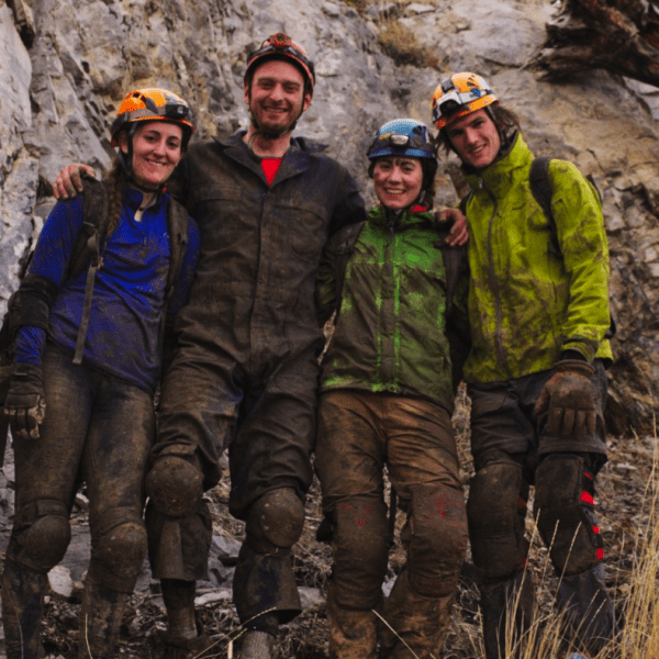 Muddy cave suits!